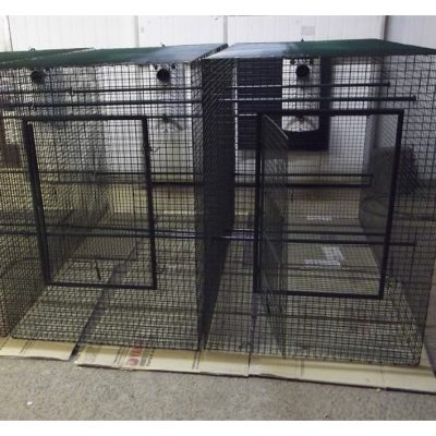 Black bird cage with door open